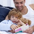 Little boy reading with his father a book — Stock Photo
