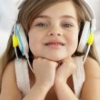 Portrait of little girl listening to the music — Stock Photo