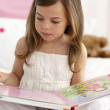 Little girl reading in bed — Stock Photo #10298560