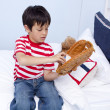 Little kid playing baseball in bed — Stock Photo #10298580