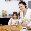 Daughter having breakfast with her mother — Stock Photo