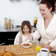 Daughter and mother having breakfast — Stock Photo
