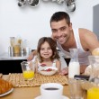 Daughter having breakfast with her father — Stock Photo