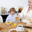 Boy having breakfast with his mother - Stock Photo