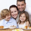 Happy family having breakfast — Stock Photo