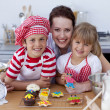 Woman and children baking in the kitchen — Stock Photo #10298674