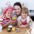 Stock Photo: Mother baking with children in the kitchen