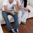 Frineds playing video games in living-room — Stock Photo #10298742