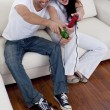 Couple having fun playing video games in living-room — Stock Photo #10298743