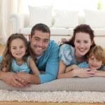 Family on floor in living-room — Stock Photo
