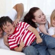 Family playing on sofa together — Stock Photo