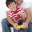 Father and son playing video games at home — Stock Photo