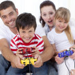 Family playing video games at home — Stock Photo