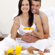 Stock Photo: Couple having nutritive breakfast in bed