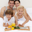 Stock Photo: Family having breakfast in bedroom