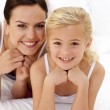 Mother and daughter lying in bed — Stock Photo