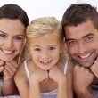 Lovely parents with their little daughter — Stock Photo