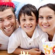 Smiling family celebrating son's birthday — Stock Photo