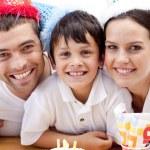 Smiling family celebrating son's birthday — Stock Photo #10299035
