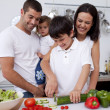 Son preparing food with his family — Stock Photo