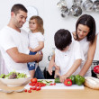 Stock Photo: Son preparing food with his family