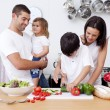 Son preparing food with his family — Stock Photo #10299385