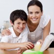 Stock Photo: Smiling mother and son making school lunch
