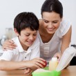 Mother and son making the school lunch — Stock Photo #10299398