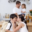 Stock Photo: Mother kissing her son before school