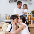 Mother kissing her son before school — Stock Photo #10299420