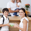 Mother giving food to her son for lunch — Stock Photo
