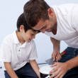 Father and son preparing paint — Stock Photo