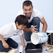 Father and son painting a bedroom — Stock Photo