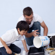 Man and little boy painting a bedroom — Stock Photo #10299487