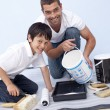 Stock Photo: Father and son painting a room