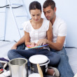 Couple chosing colours to paint new house — Stock Photo