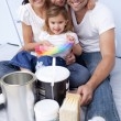 Family with colour samples to paint new house — Stock Photo