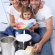 Family chosing colours to paint new house — Stock Photo