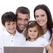 Royalty-Free Stock Photo: Portrait of young family using a laptop at home