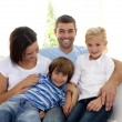 Stock Photo: Playful family sitting on sofa at home
