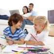 Brother and sister painting in living-room — Stock Photo