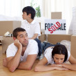 Tired family relaxing on floor after buying new house — Stock Photo