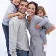 Stock Photo: Happy parents giving children piggyback rides
