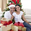 Happy couple celebrating Christmas at home — Stock Photo #10299912