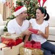 Happy couple giving presents for Christmas — Stock Photo