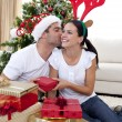 Happy couple giving presents for Christmas at home — Stock Photo #10299925