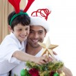 Dad and boy decorating Christmas tree — Stock Photo