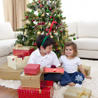 Happy children celebrating Christmas at home — Stock Photo