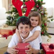 Happy brother and sister celebrating Christmas — Stock Photo