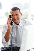 Attractive businessman on phone — Stock Photo